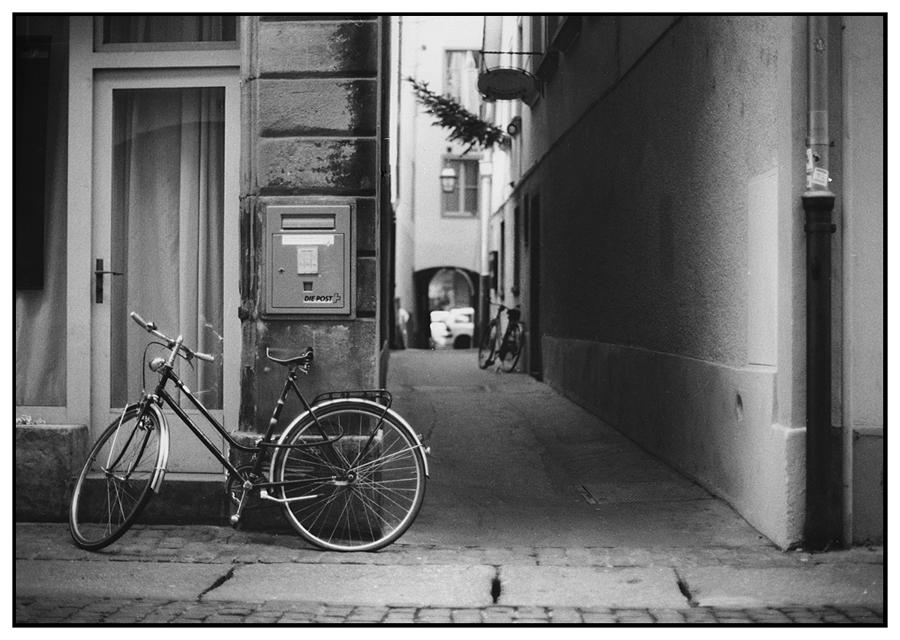 a mailbox, a bike and a christmas tree