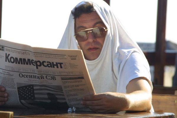 a man reding a newspaper