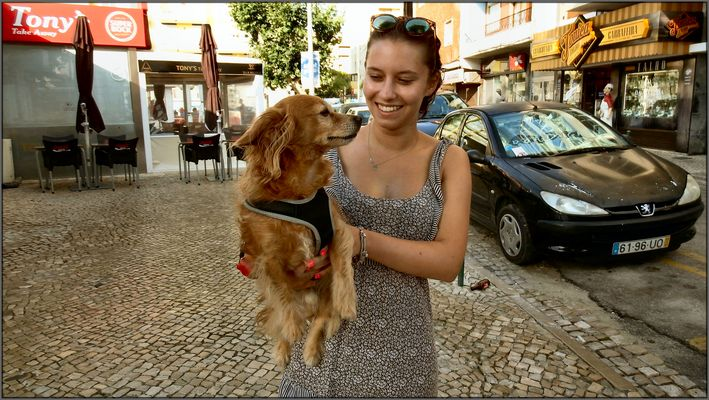 A nice little dog and her german owner.