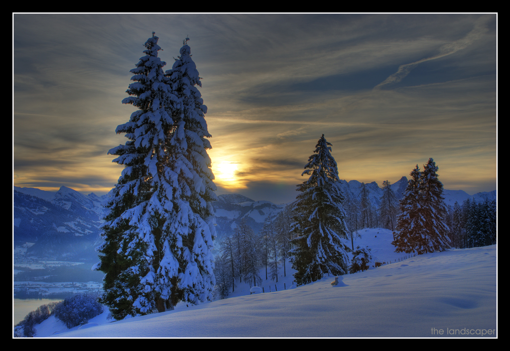 a snowy landscape and the sun