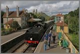a steam train at corfe castle station 1A