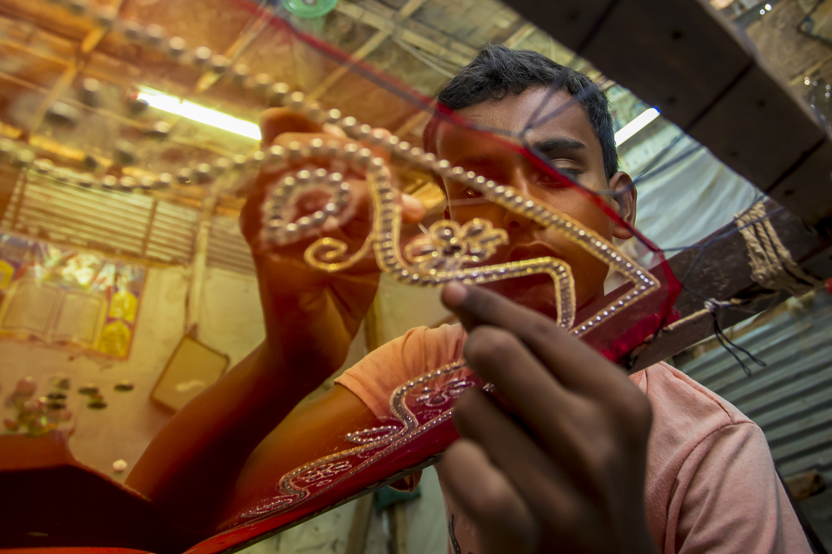 A teenager (Rohit, 12 years) adds detail to a traditional Jamdani saree.
