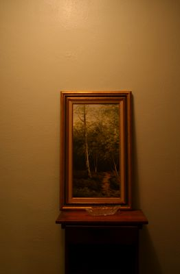 A tree sits in the painting
