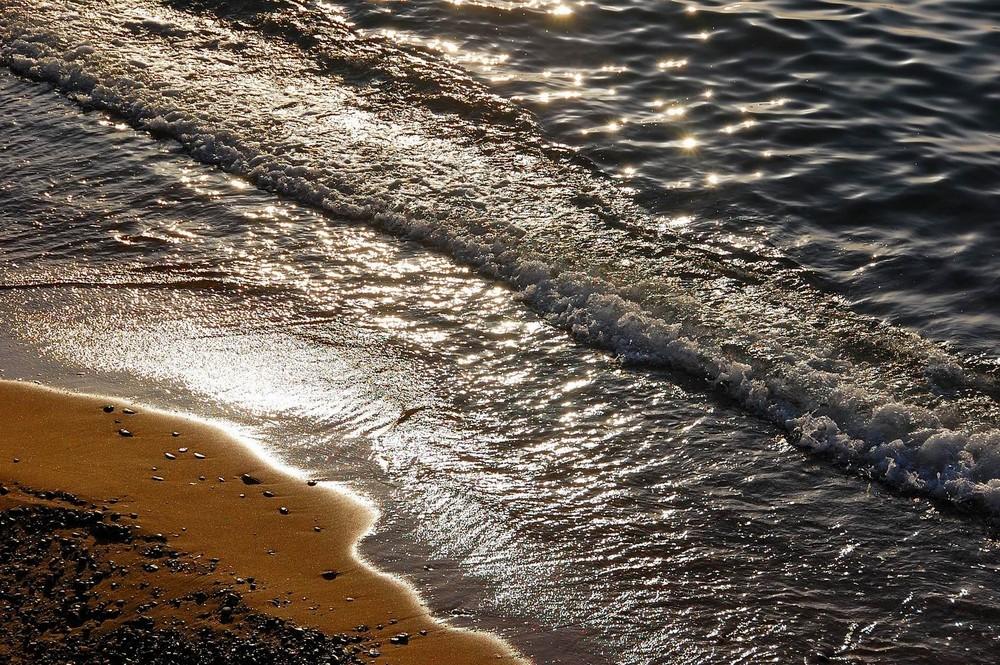 Abendsonne, Meer und Sand