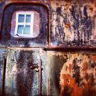 Alte Bahntür. Window in a window.