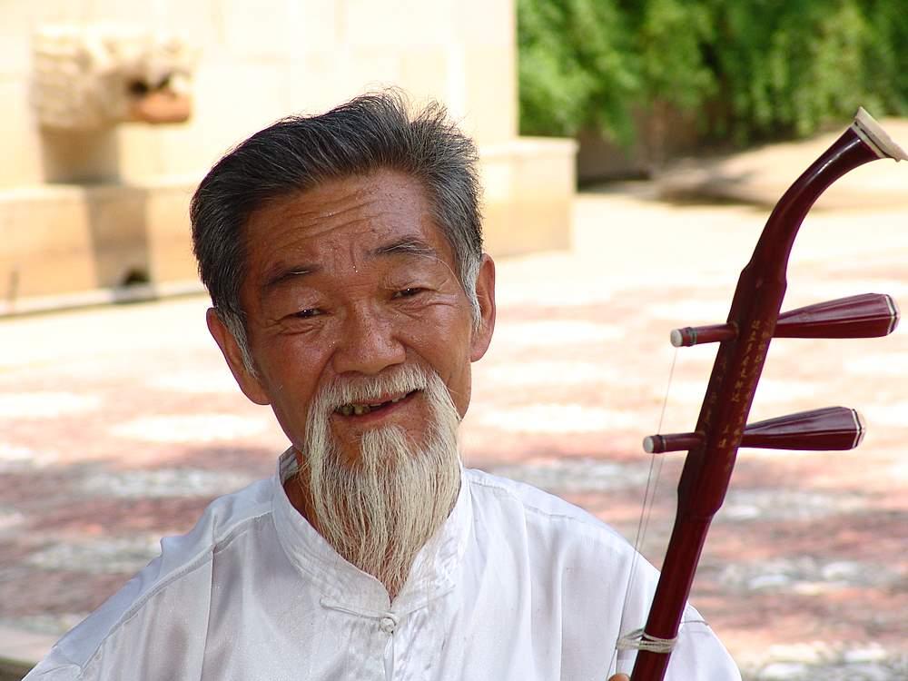 Alter Chinesischer Straßenmusikant