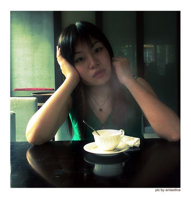 Angela in a cafe