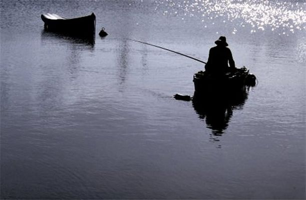 Angler im Licht