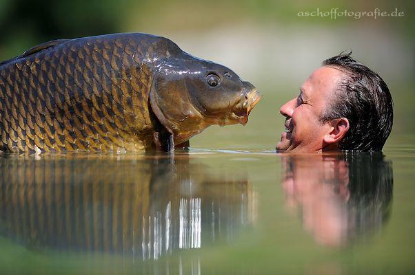 Angler mit Fang