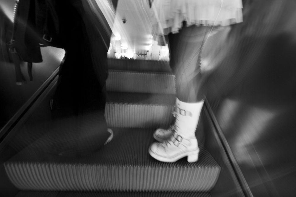 ...auf der Rolltreppe