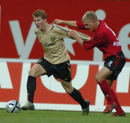 Bastian Schweinsteiger (li.) - Andreas Wolf