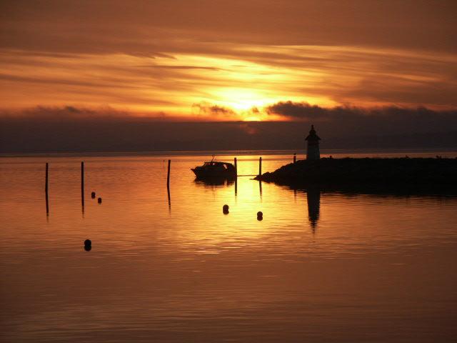 Båd i solnedgang