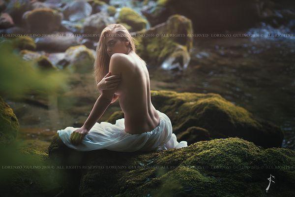 Beautiful woman posing in green pond