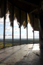 Behind curtains
