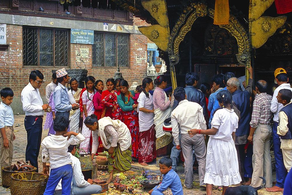Believers give offerings to the Hindu deities