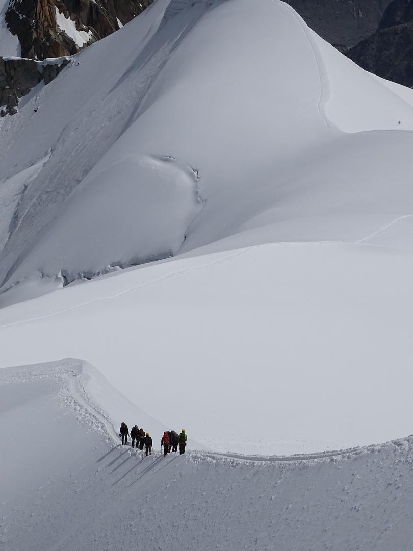 Bergsteiger am L`Aiguille Du Midi