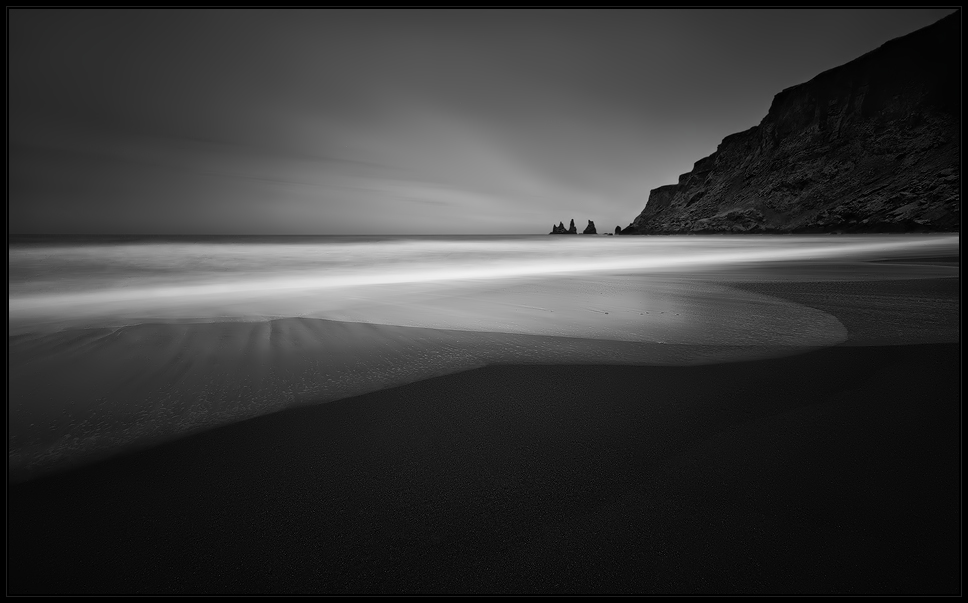 [ ... black beach ]