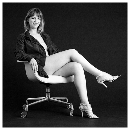 Black Suit On A White Chair