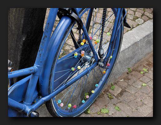 Blue bicycle wheel