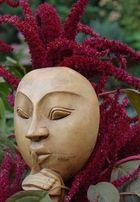 Blumen tragen Gesichte