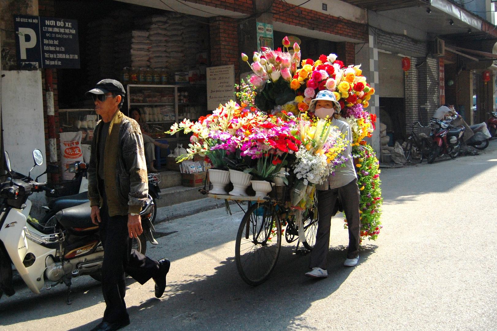 Blumenverkäuferin Hanoi