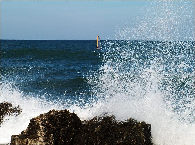 Brandung mit Surfer
