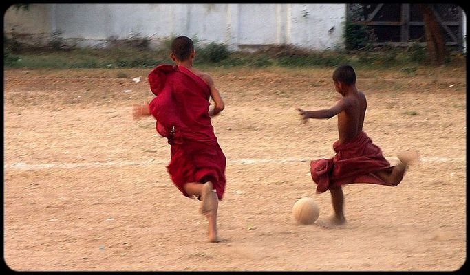 Burmese Buddhist novices playing football