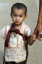 Burmese refugee boy with father