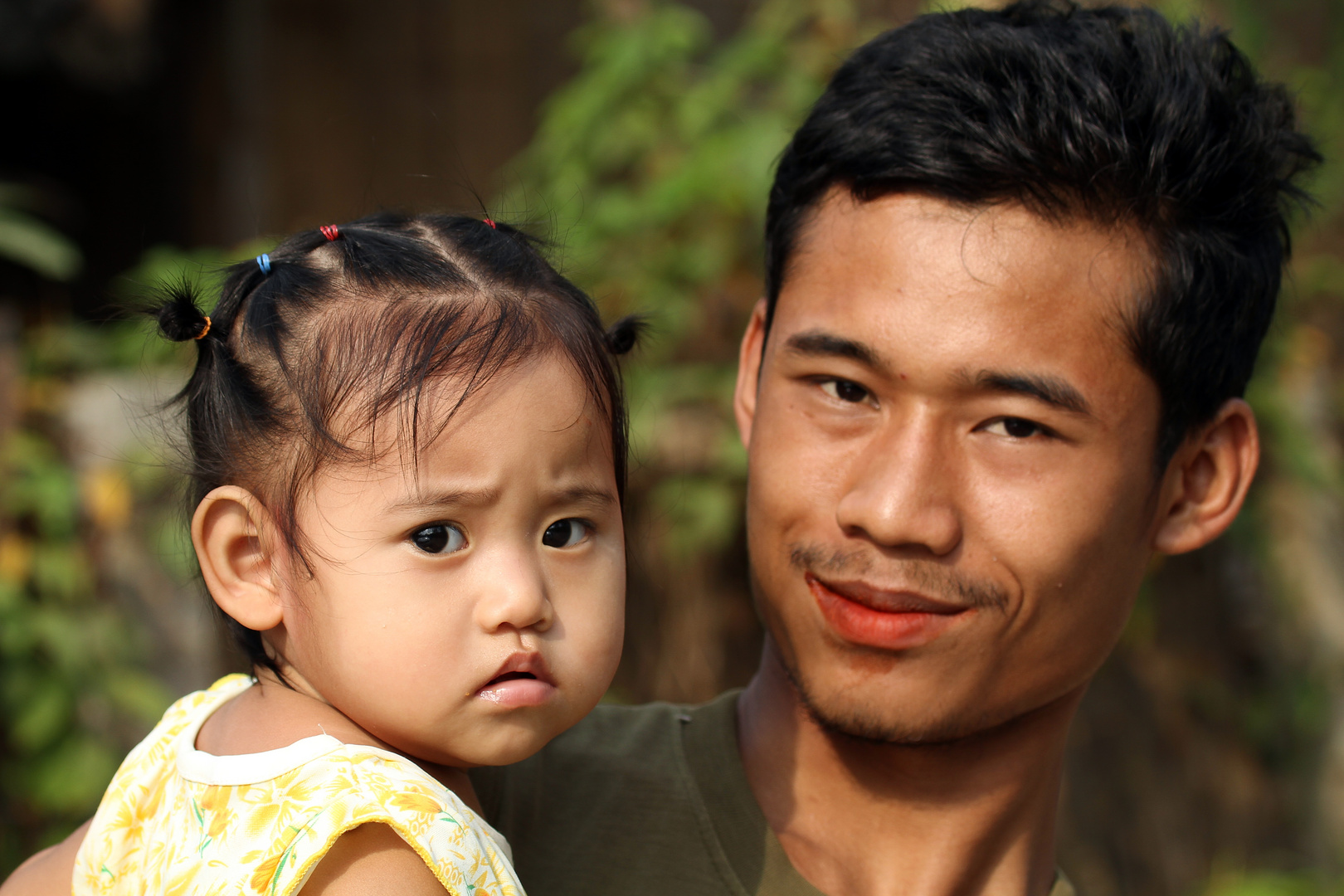Burmese refugee daughter with father