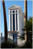 Caesars Palace between palms