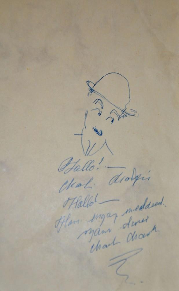 Charlot, sa signature sur le livre d'or du restaurant La vieille ferme à Montreux
