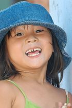 Child with blue hat