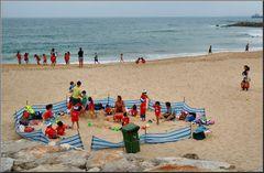 Children on beach with their teachers.