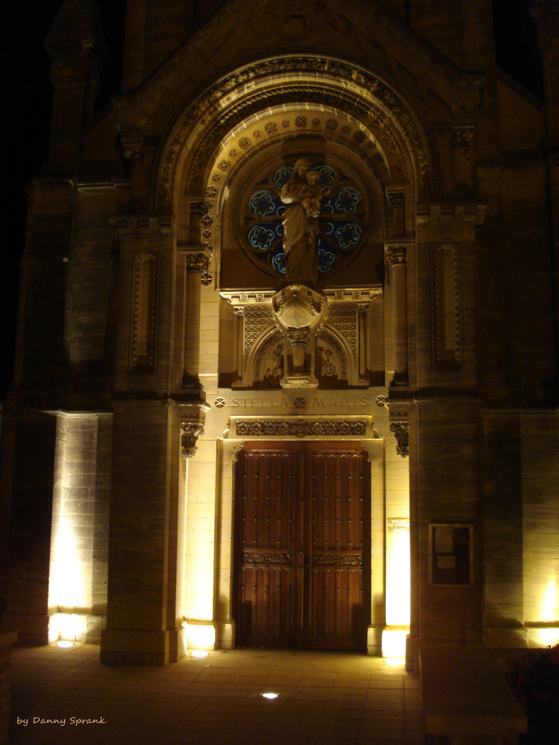 church at night in Arromanches