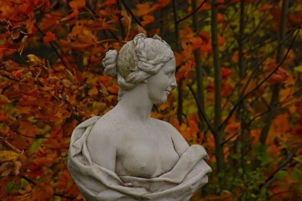 Classic sculpture in autumn park