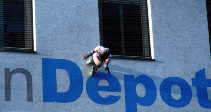 Climb the wall to the depot