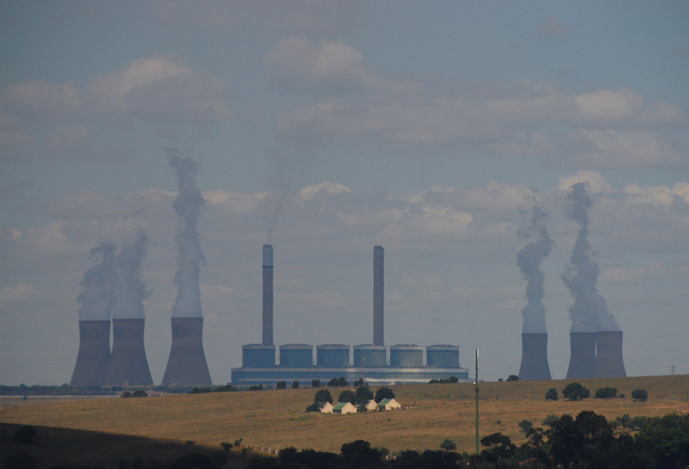 coal powerplant behind the hills