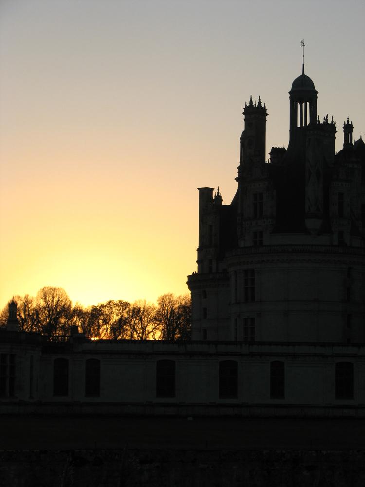 couché de soleil sur le chateau