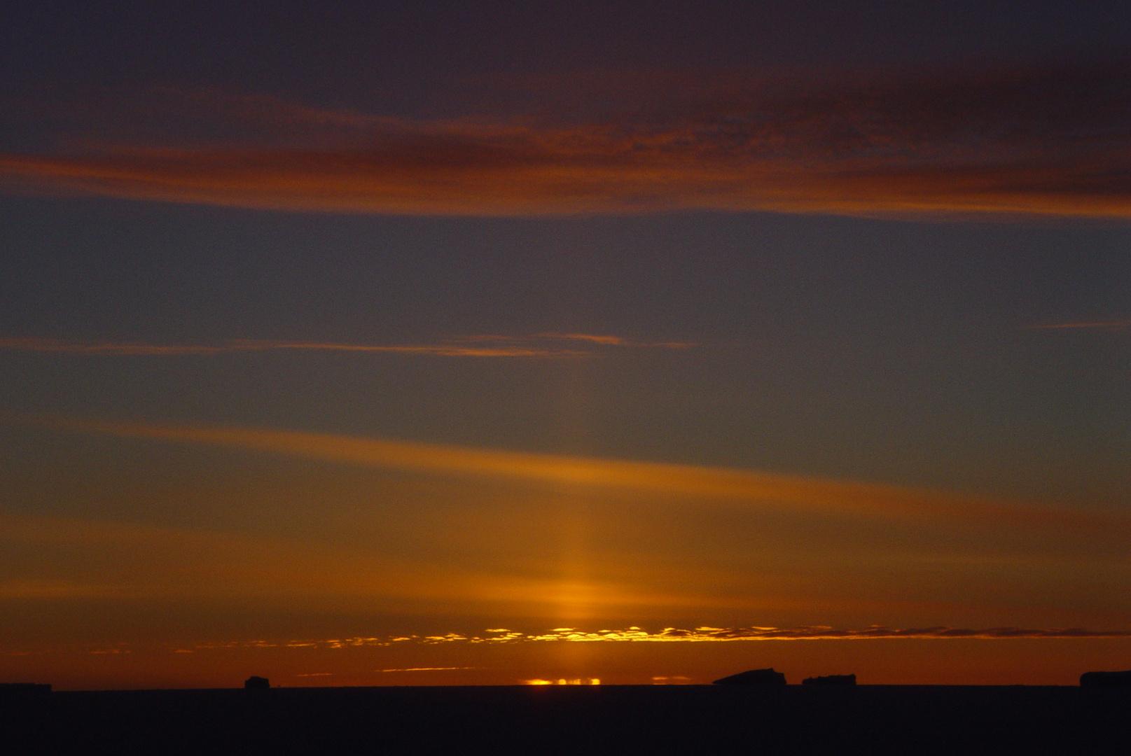 coucher de soleil et dernier rayon