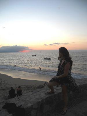 Cristina, el mar y el atardecer