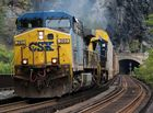 CSXT#360 AC44CW leads an Enclosed Carrier Car Freight Train near Harpers Ferry,USA