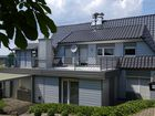 Dach mit Tonziegeln und Fassade mit Alu Paneel