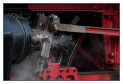 dampfendes Lokomotivendetail mit Mittwochsmutter