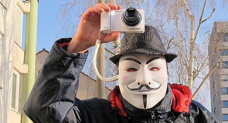 Der Fotograf mit der Maske