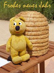 Der gelbe Bär wünscht euch ein frohes neues Jahr