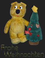Der gelbe Bär wünscht Frohe Weihnachten