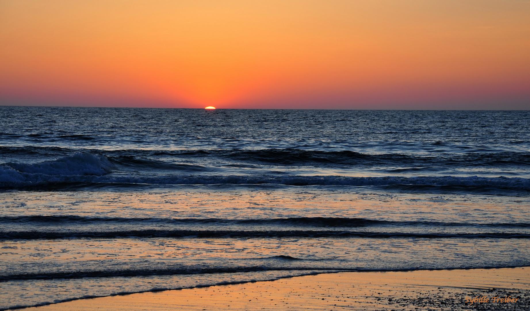 Die Sonne im Meer versinken sehen