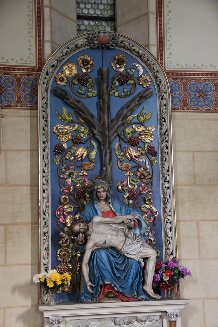Die Weltesche Yggdrasil wächst aus der Pieta