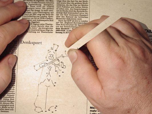 Die Wochenendzeitungsbildaufgabe