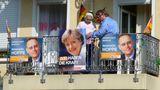 Diskussion vor der Wahl auf einem deutschen Balkon von Günter Walther
